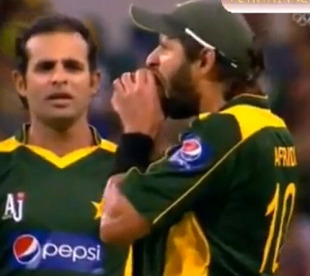 Afridi biting the ball but, he is not the first one to bite.