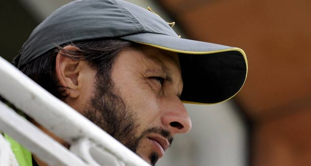 Shahid Afridi contemplating from the players gallery at Lords whether to stop or go?